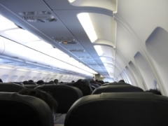 rear-view-of-passengers-in-an-airplane-1342969-m